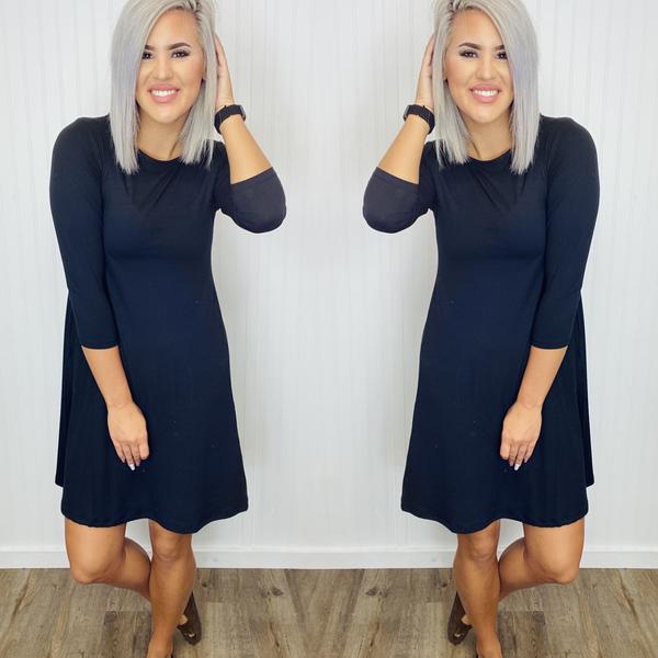 YELETE- 3/4 Sleeve Swing Dress Featuring Side Pockets