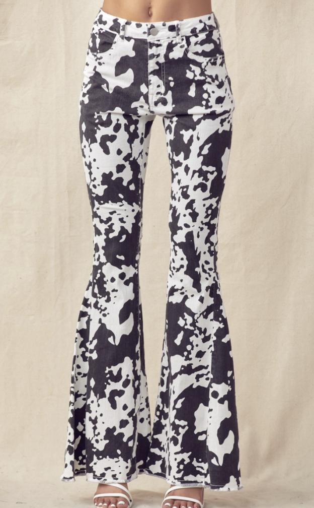 COW PRINT FLARED DENIM PANTS WITH FRAYED HEM- BLACK/WHITE