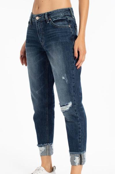 Medium wash distressed boyfriend fit jeans with cuffed hemming