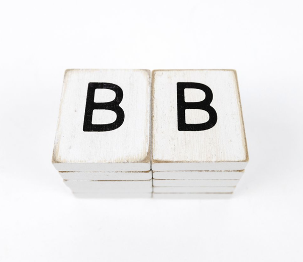 White Tiles With Black Letters