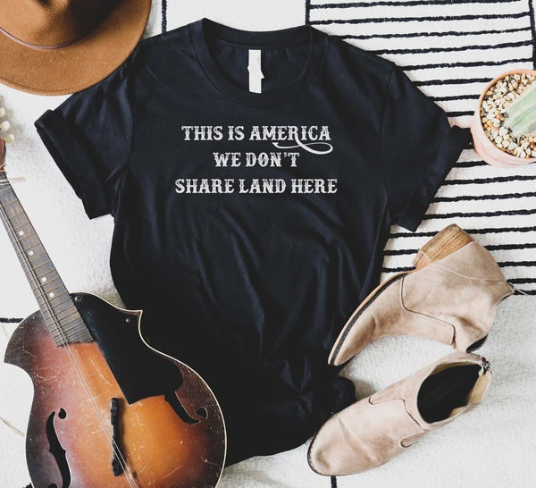 We Don't Share Land Graphic Tee