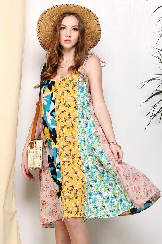 Mix and match floral print dress with tassel trim