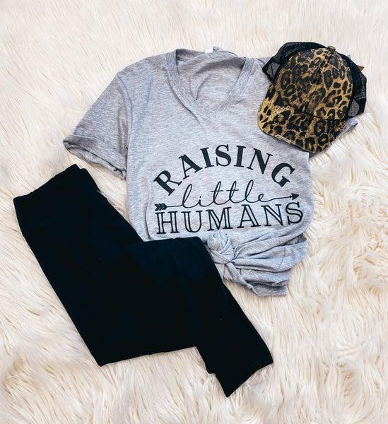 << RAISING LITTLE HUMANS >>