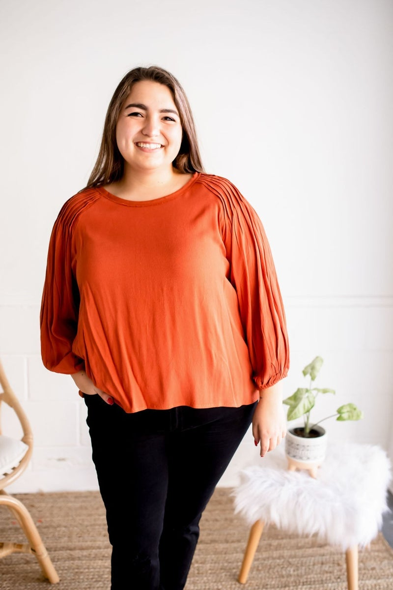 RUST PLEATED LONG SLEEVE TOP