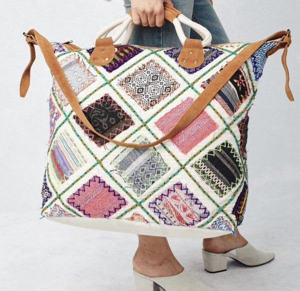 Lovestitch Applique patchwork weekender with suede handles and crossbody strap
