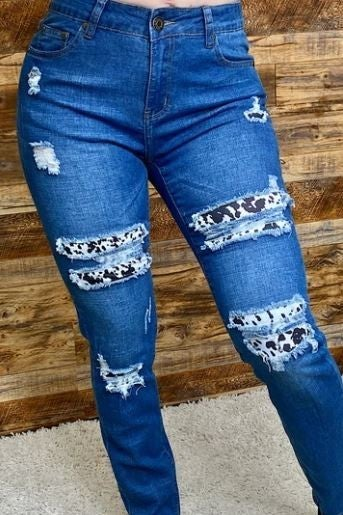 Blue denim jeans w/cow printed patches PU