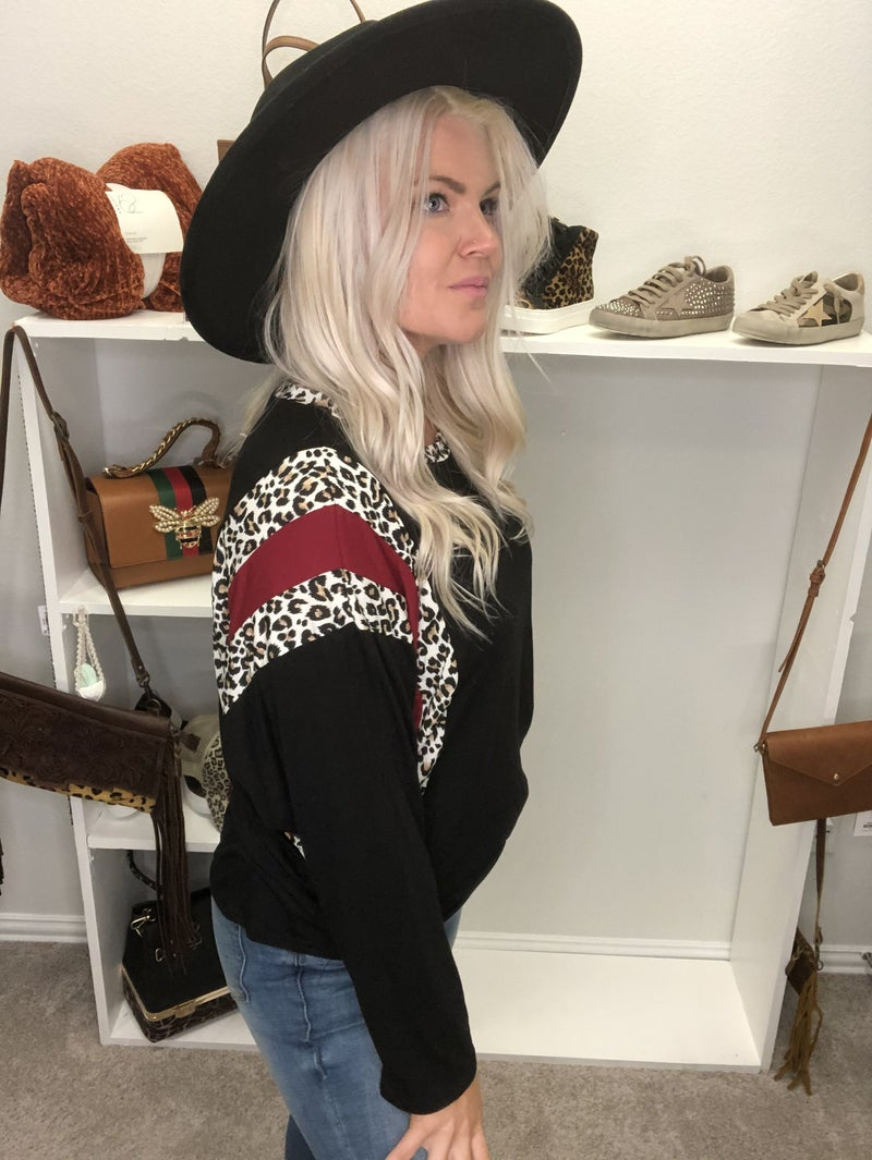 Black long sleeve top with maroon and leopard accents