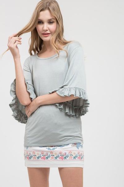 Round neck, knit, top with ruffled sleeves
