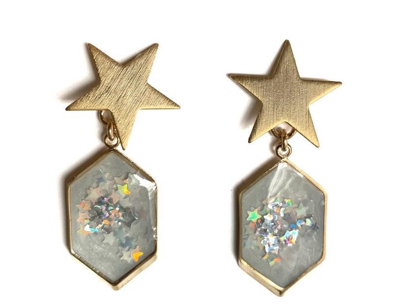 Detail and Tassel Earrings: Star Huggie