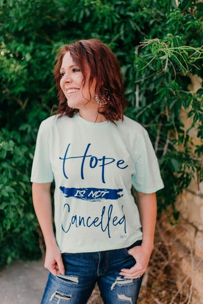 Hope is not cancelled graphic tee