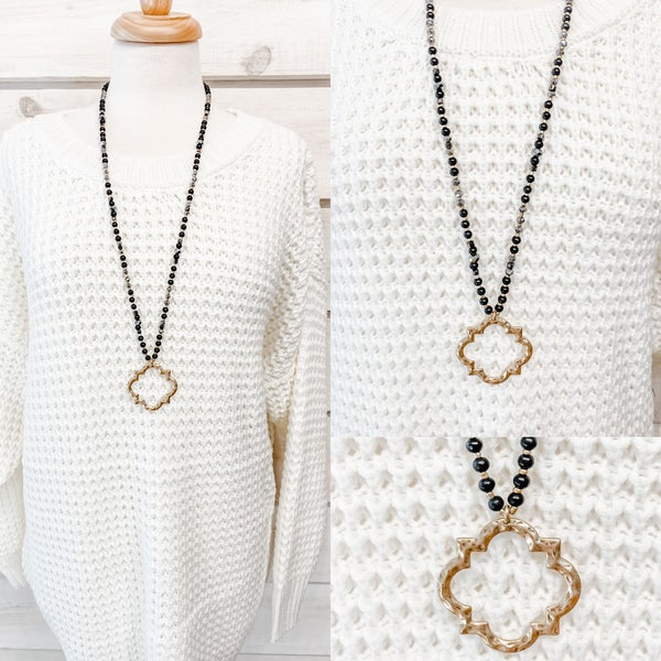 Black Beaded Necklace with Open Gold Charm