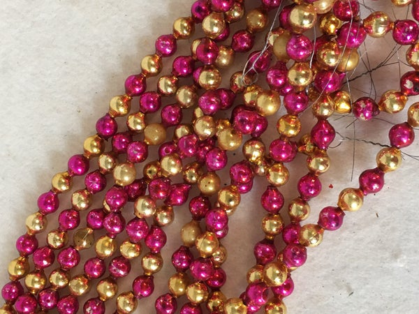 """6 30"""" pink & gold Mercury glass strands, made in Japan."""