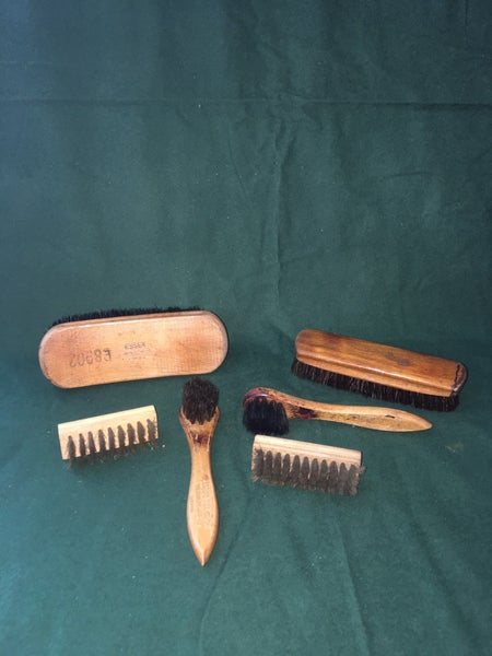 Collection of vintage shoe shine brushes