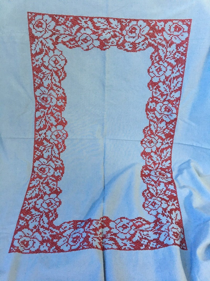 Blue tablecloth, red embroidery