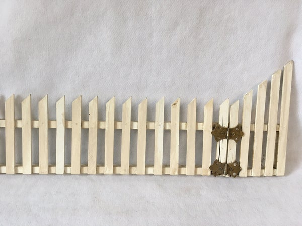 Vintage wooden picket fence section