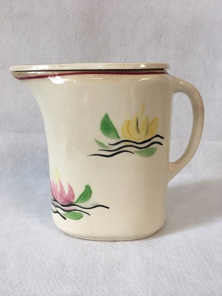 Vintage covered pitcher with water lilies