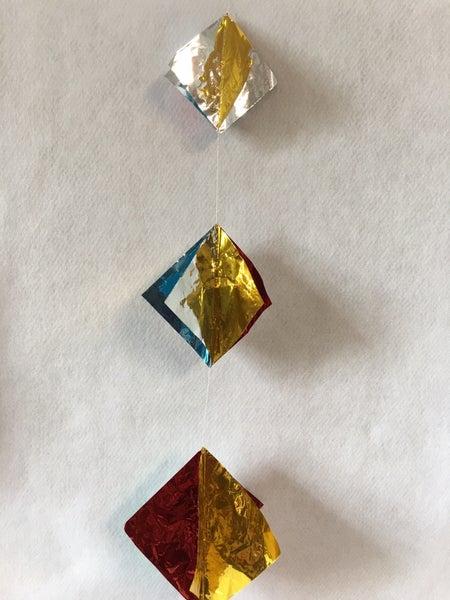 Metallic square garland, new old stock in original packaging
