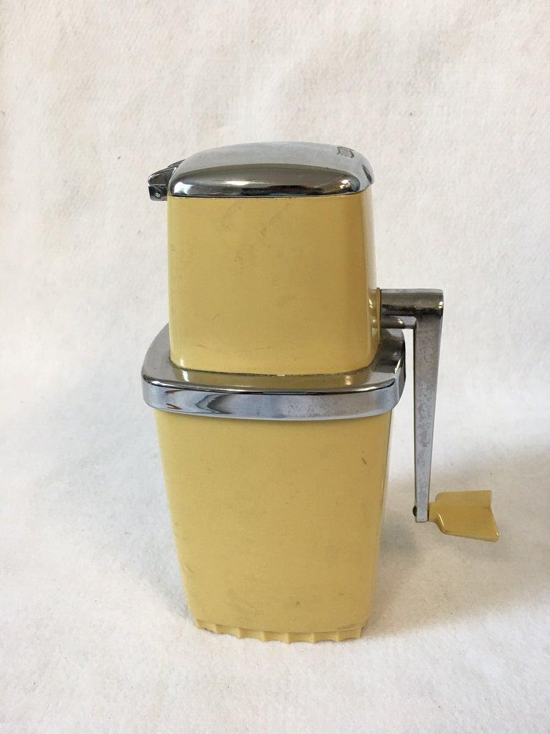 Vintage swing away ice grinder