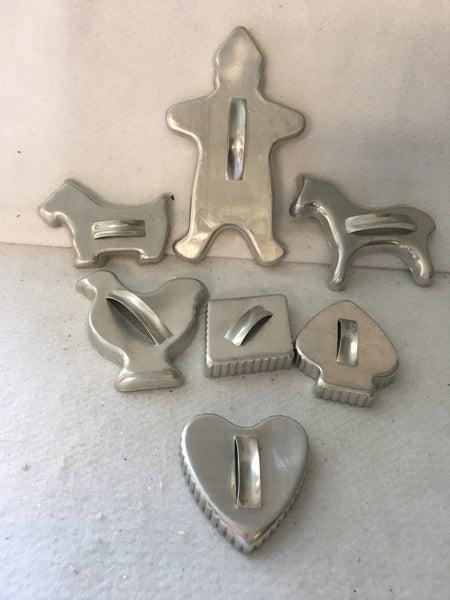 7 vintage aluminum cookie cutters