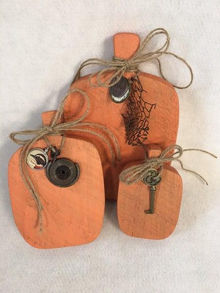 Trio of wood pumpkins