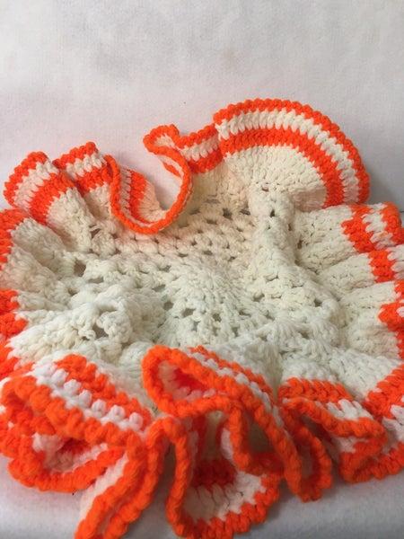 Orange & white doily