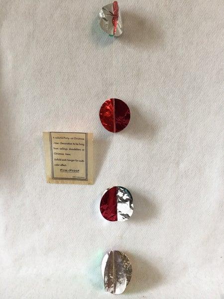 Metallic circle garland, new old stock in original packaging