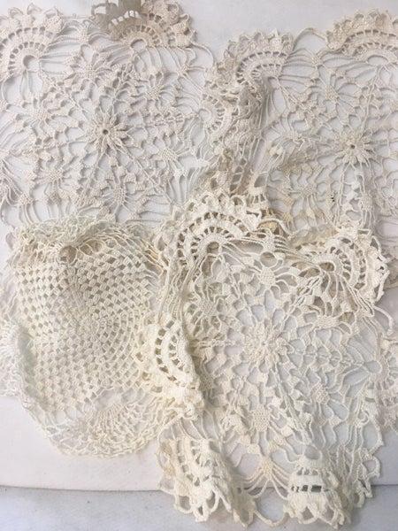 Open weave doilies, set of 4