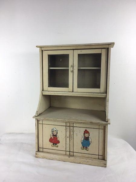 Primitive child's step back cupboard