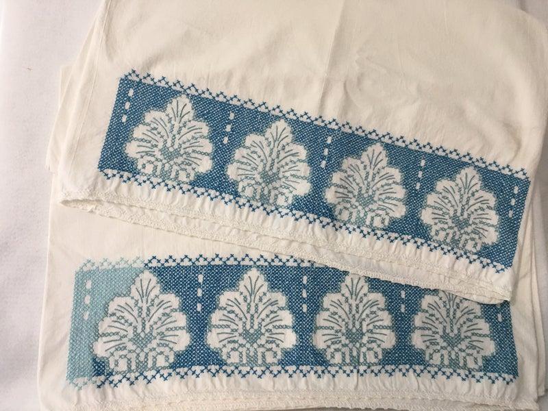 Pair of vintage cross stitch pillowcases