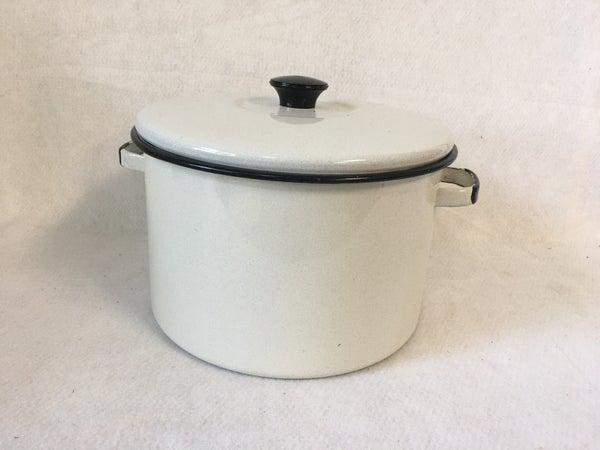 White enamelware pot with lid, black rim