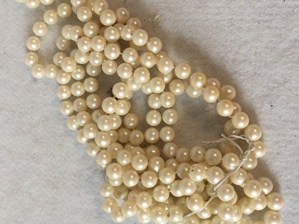 White beads, 9 ft.