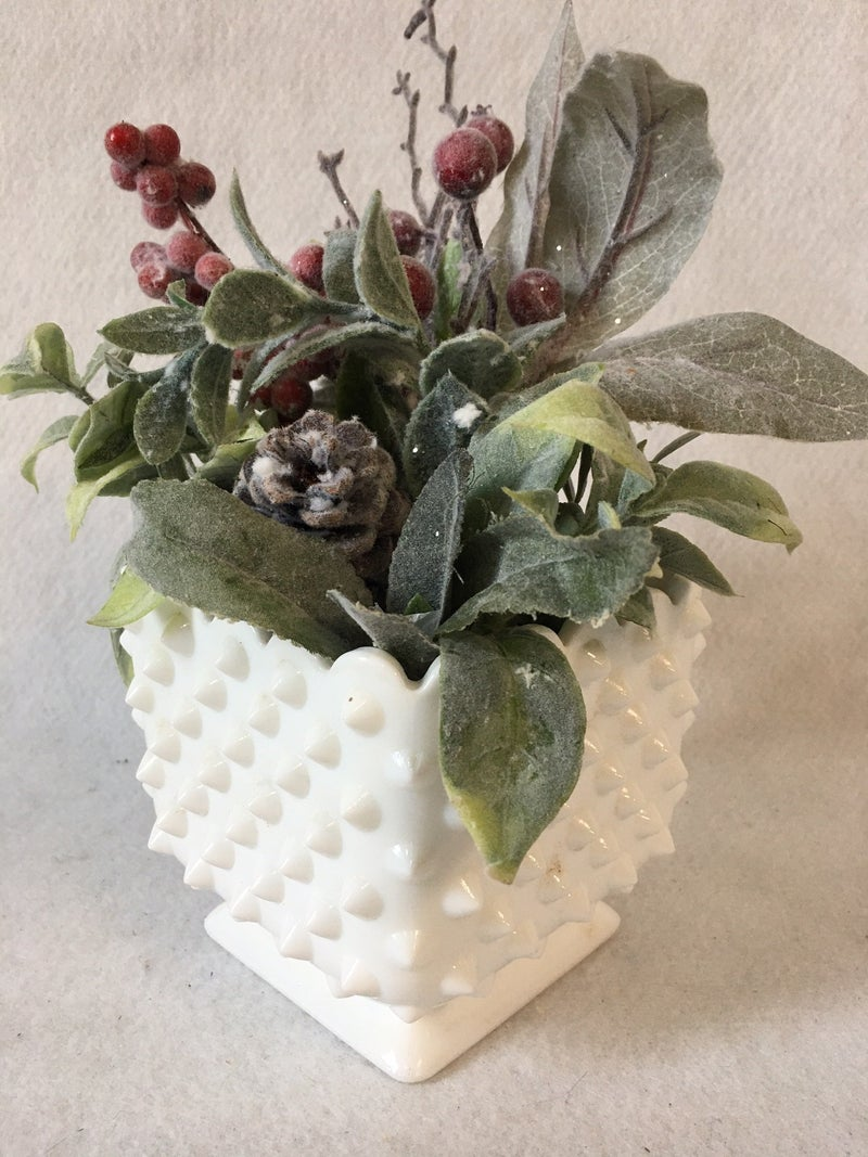 Hobnail vase with holiday floral