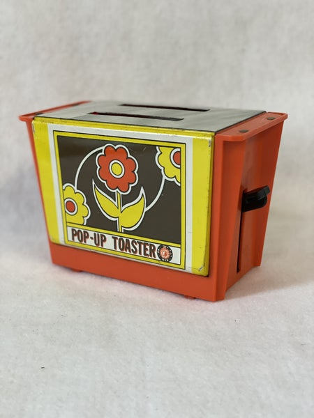 Vintage metal & plastic toy toaster