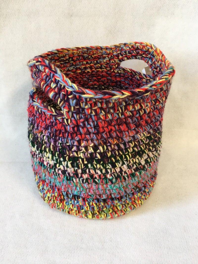 Crocheted two handled basket