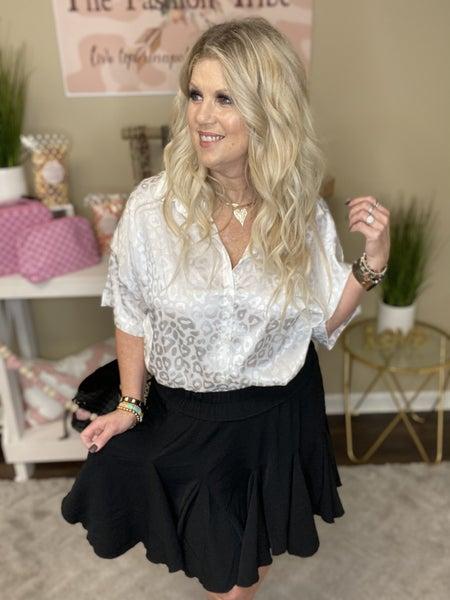 Flirty black skirt with ruffle inserts