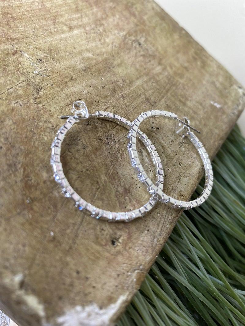 Silver and rhinestone hoop earring q