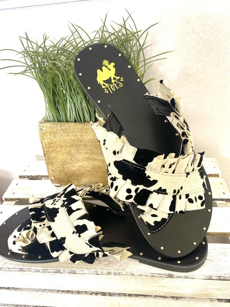 Cow print slide with stud trim