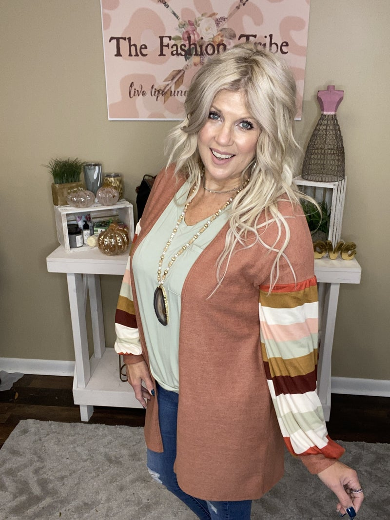 Rust cardigan with striped sleeve