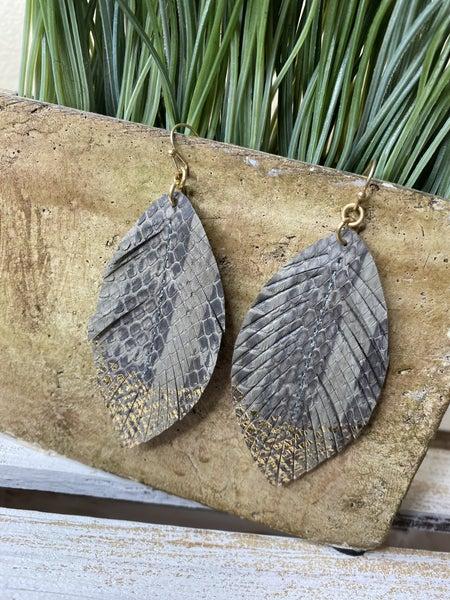 Gold dipped gray snake earrings
