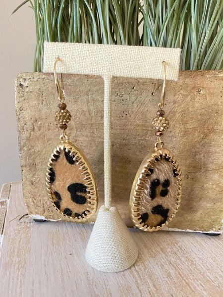 Draped in gold leopard earring