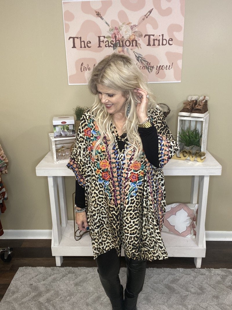 Floral embroidered poncho by Oddy