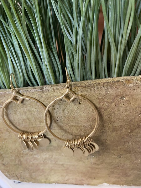 Worn gold disc hoop earrings