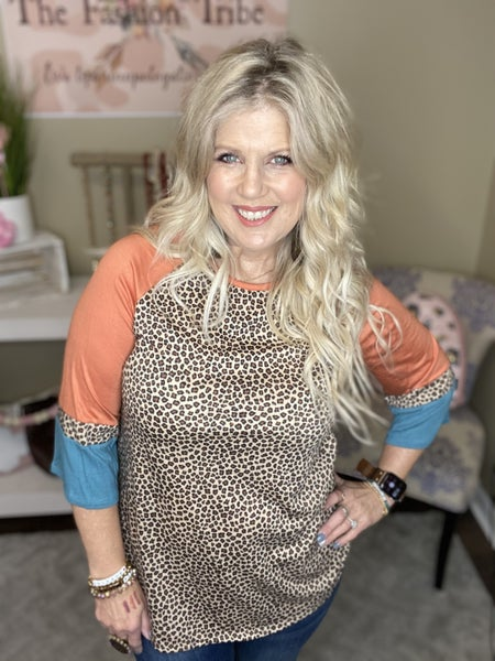 Wild for Coral flutter sleeve top by Jade by Jane