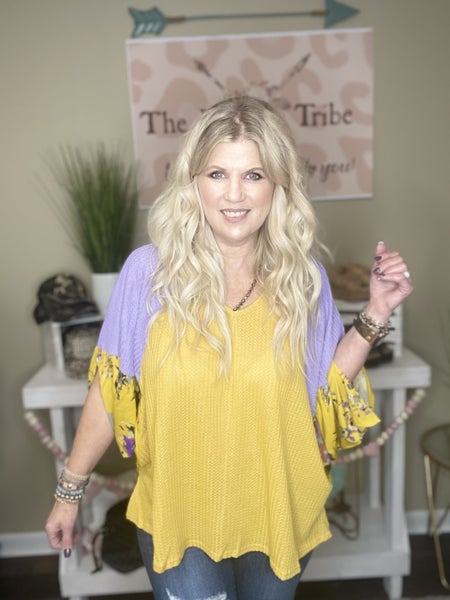Goldenrod Waffleknit top with purple floral sleeves