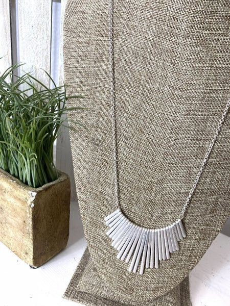 Rock the metal crested bar necklace