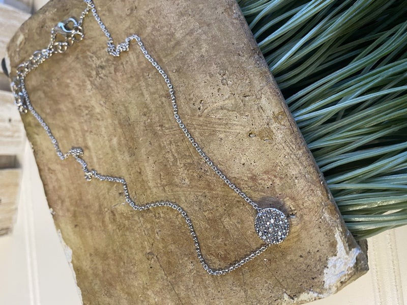 Silver necklace with shimmer charm
