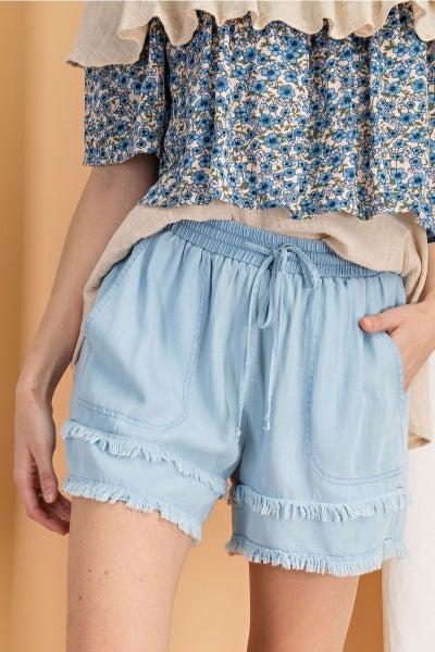Chambray shorts with fringe hem