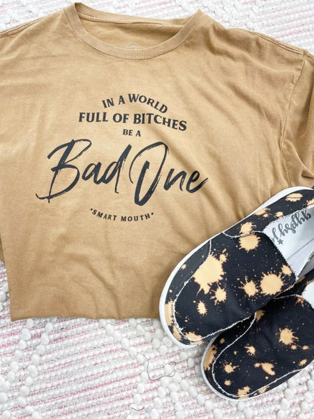 In A World Full of Bitches Be A Bad One Graphic Tee