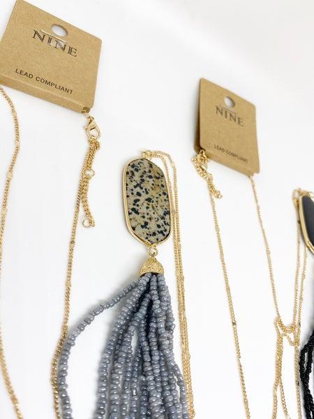 Nine Gold Pendant Tassel Necklace