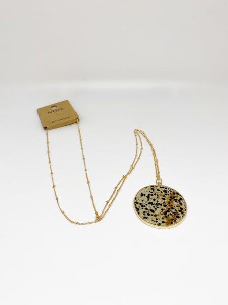 Nine Tan Circle Pendant Necklace